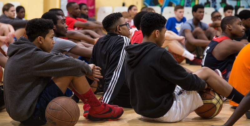 london thunder players basketball camp listening coach